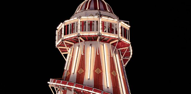 Photograph of a Helter Skelter at night to illustrate the text
